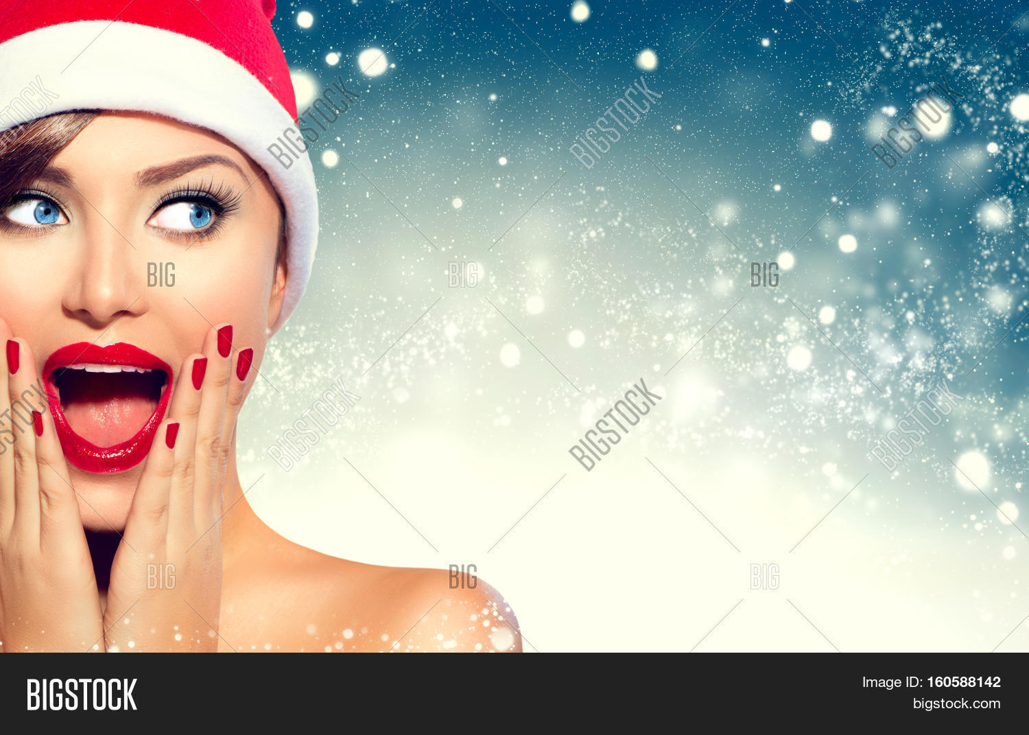 ce1f6a2c20104 Christmas Girl. Beauty model woman in Santa Claus hat with red lips and  manicure looking