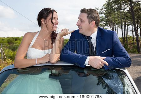 Marriage Couple In Convertible Car, In Country Summer