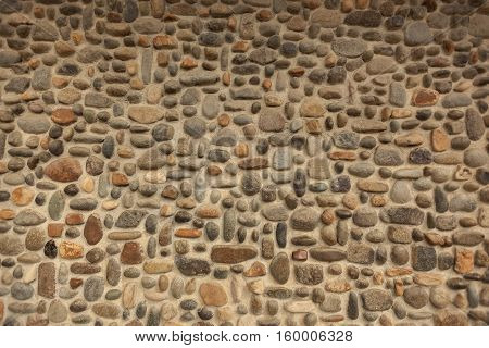 A picturesque pebble stone wall mosaic image.
