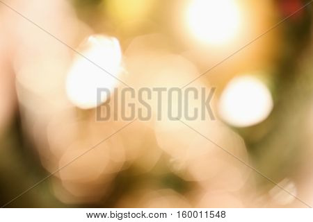 Abstract background of blurred golden Christmas Tree lights bokeh circles for holiday background.