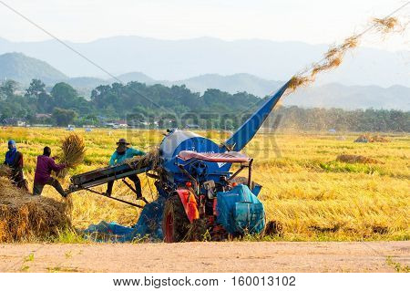 Threshing machine working in rural areas in Lampang Thailand