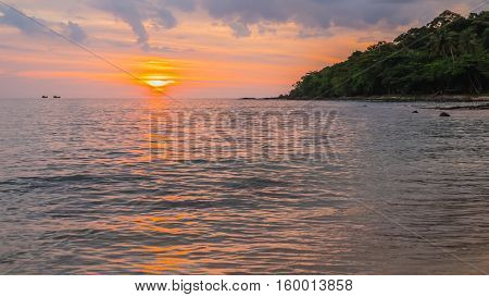 A beach scene with sunset in the background at Kood island Thailand.Landscape of The beach with sunset at Koa Kood in Thailand.