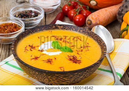Vegetable cream soup with saffron. Studio Photo