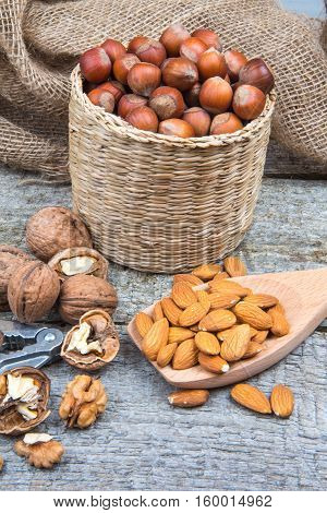 Almonds, Walnuts And Hazelnuts On An Old Rustic Wooden Background