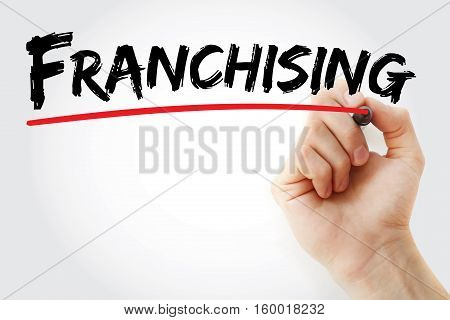 Hand Writing Franchising With Marker