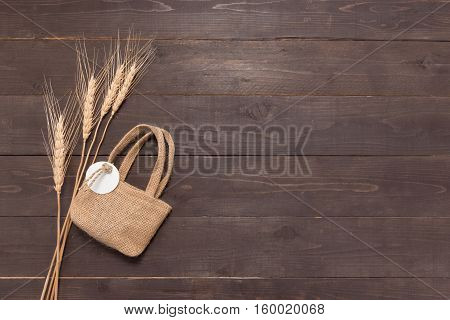 Hessian Sack Bag With Rice Bale On The Wooden Background