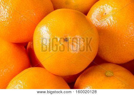 Food background of fresh healthy ripe orange clementines tangerines or mandarins