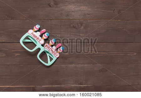 Gree Glasses With Happy Birthday Massage Is On The Wooden Background