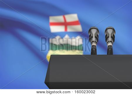 Pulpit And Two Microphones With Canadian Province Flag On Background - Alberta