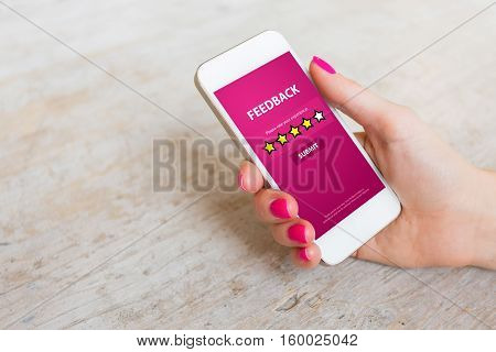 Customer Feedback Form on Mobile Phone in womans hand