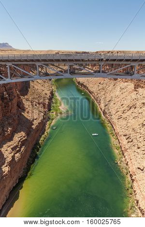 the nNavajo bridge spans over the Colorado river in marble canyon Arizona