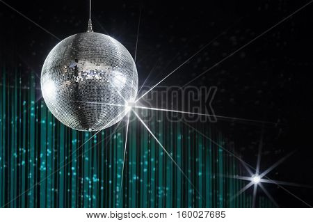 Party disco ball with stars in nightclub with striped turquoise and black walls lit by spotlight, nightlife entertainment industry