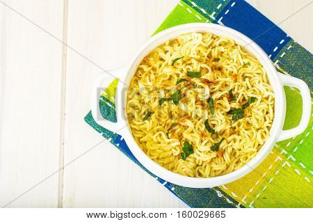Instant soup with Chinese noodles. Studio Photo
