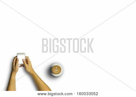 Top View Of Business People Using A Smartphone With A Cup Of Latte Coffee On White Desk Background.v