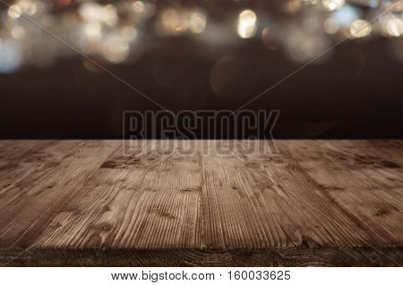 Background for celebrations in front of an empty wooden table for a concept
