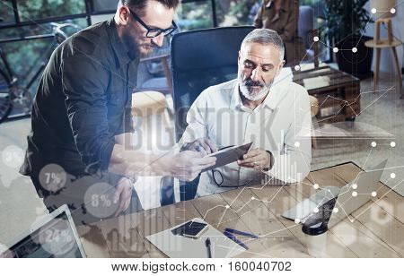 Concept of digital screen, virtual connection icon, diagram, graph interfaces.Young bearded man showing startup idea on mobile tablet.Adult businessman finding great business idea with partner.Blurred