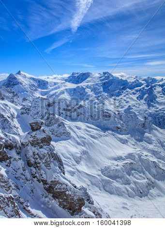 Alps, view from the top of Mt. Titlis in Switzerland. Mount Titlis is a mountain located on the border between the Swiss Cantons of Obwalden and Bern, mainly accessed from the town of Engelberg.