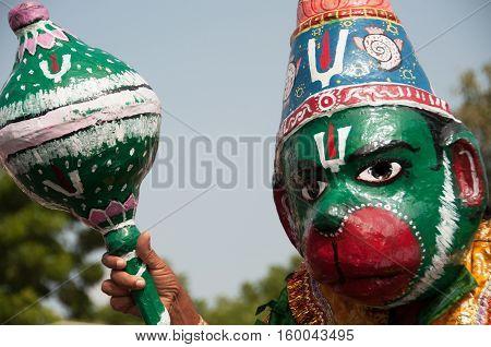 Hanuman like costumed man at a Hindu celebration