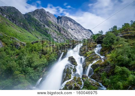 Briksdalsbreen waterfall long exposure and close view photo. Norway national park and popular hiking path.