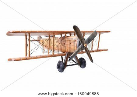 Close up of an old wood toy plane on a white background