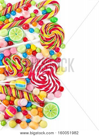 Colorful Candies And Lollipops Isolated On A White Background. Top View.