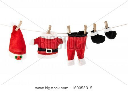 Santa Claus holiday suit hanging on clothesline. Christmas theme. Horizontal. Front view.
