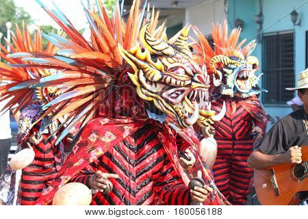 Diablicos or Devils dancing on the streets of Los Santos Panama celebrating Corpus Christi
