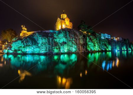 Night View Of The Church Of Metekhi And A Statue Vakhtang Gorgasali Over The River Mtkvari (kura), T