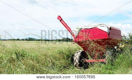 Trailer grain transfer bin sitting on a rice field in Panama