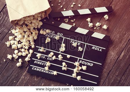 movie clapper board with fresh popcorn