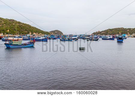 Vietnamese fishing boats all harboured in a village bay