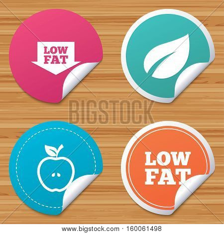 Round stickers or website banners. Low fat arrow icons. Diets and vegetarian food signs. Apple with leaf symbol. Circle badges with bended corner. Vector