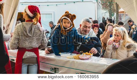 Family Eats Chips In A Small Market Tent