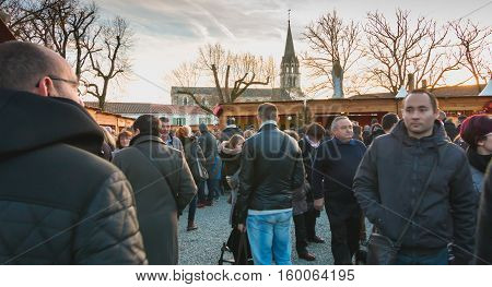 Public Walking In The Midst Of The Stalls Of The Christmas Market
