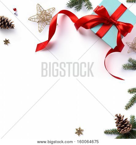 Christmas holiday composition; Christmas gift fir tree branches and Christmas ornament on white background. Flat lay top view