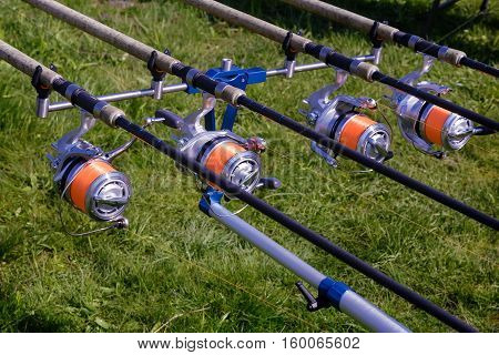 On the banks of the river set of gear for catching fish: English feeder - fishing tackle for fishing easy rod and reel.