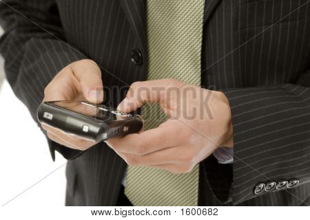 Businessman Texts On Mobile Device