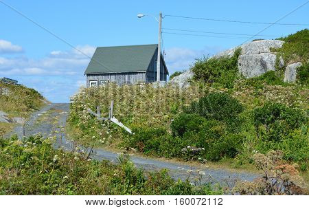 A weathered wooden shed on the hill at Peggy's Cove, NS.