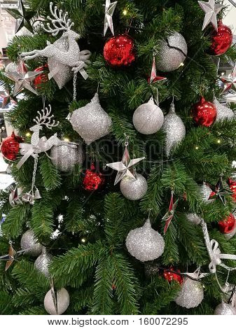 Embellished Christmas tree decoration glitter silver ornaments and red ball (long shot)