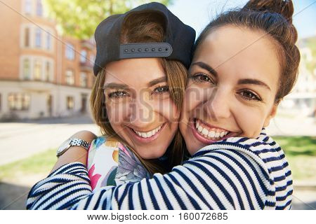 Two Happy Young Girls In An Intimate Hug