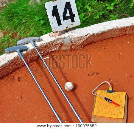 Two sticks and ball mini golf scene