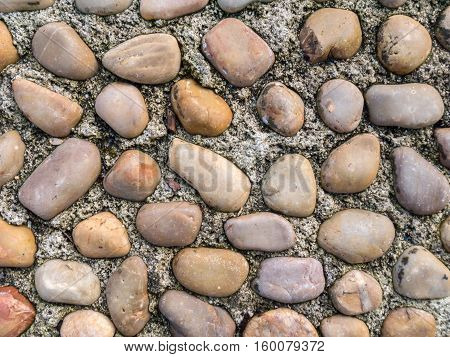 Pebble and concrete old roadway pavement background