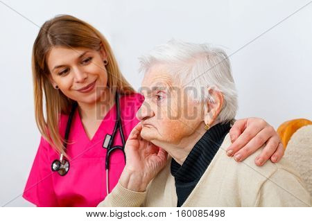 Picture of a disabled senior woman with her caregiver