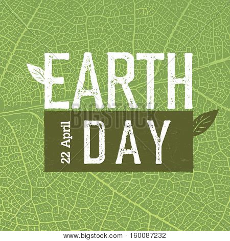 Grunge Earth Day Logo on green leaf veins texture.