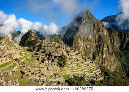 View of the Lost Incan City of Machu Picchu with clouds near Cusco, Peru. Machu Picchu is a Peruvian Historical Sanctuary.