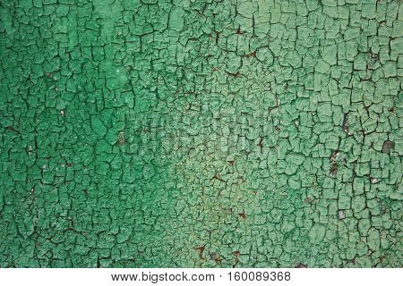 Green rusty background rough rough texture in the cracks. Corrosion of metal iron. The Army the city banner billboard