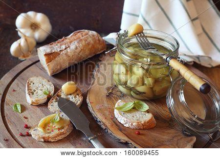 Appetizer: garlic confit in jar and franch spread bread