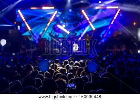 Hand with a smartphone records live music festival Taking photo of concert stage live concert music festival happy youth luxury party landscape exterior.