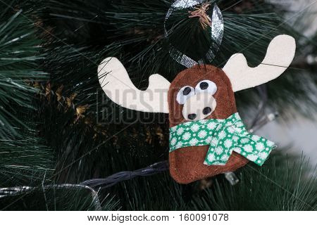 Handmade toy from felt on Christmas tree