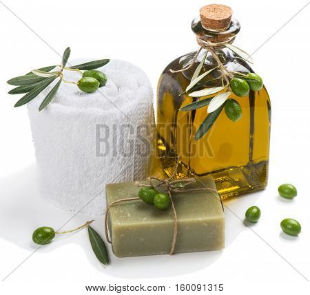 Olive oil soap and bath towel decorated with green olive fruits isolated on white background. Spa concept.